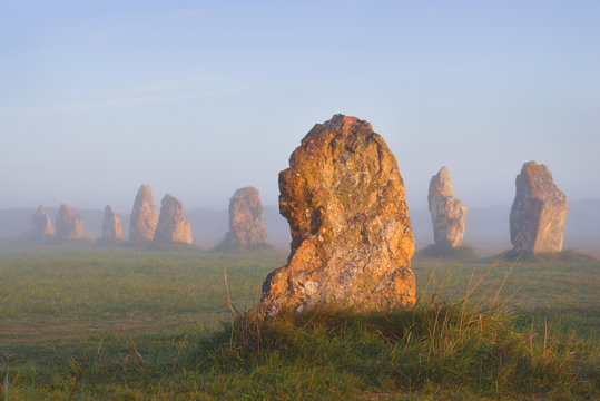 Menhir alignment view at Camaret sur mer at sunrise during fog