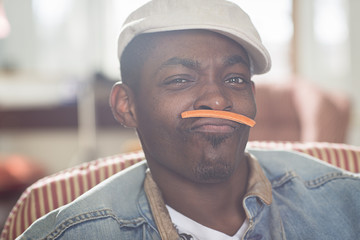 Portrait of mid adult man with carrot mustache