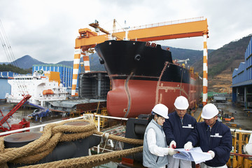 Workers discussing plans at shipyard, GoSeong-gun, South Korea