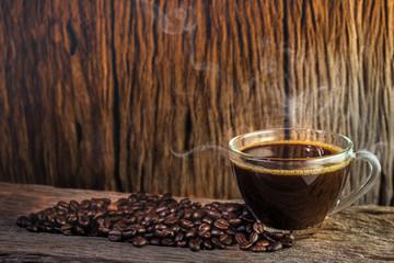 coffee mug and coffee breans on wood backgound