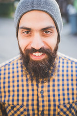 Portrait of mid adult man wearing beanie hat, outdoors
