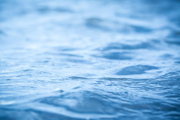 wave on the clean beautiful blue water close up, low Angle view