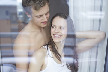 Young couple by window