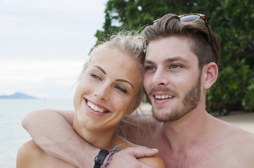 Portrait of young couple on beach, Kradan, Thailand