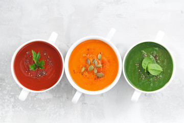 assortment of colorful vegetable cream soup