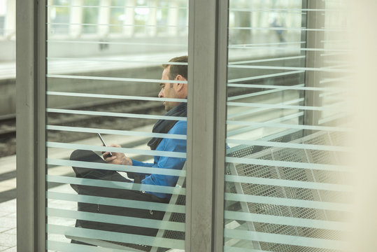 Mature man using cell phone