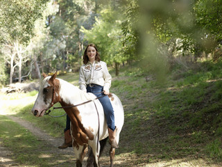 Portrait of teenage girl bareback riding horse