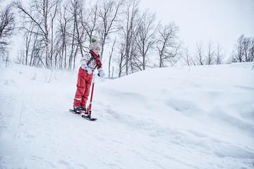 Boy playing on snow scooter, Hemavan,Sweden