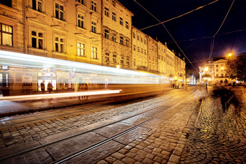 Street with tramway rails and tracks from headlights