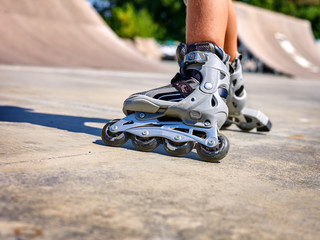 Roller skate legs close up  in skatepark. Low section. Roller skates is extreme sport.