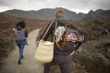 Family hiking on path, Fairy Pools, near Glenbrittle, Isle of Skye, Hebrides, Scotland