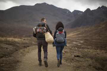 Family hiking on path, Fairy Pools, near Glenbrittle, Isle of Skye, Hebrides, Scotland