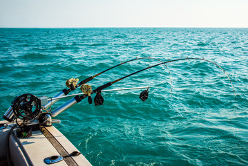 Two Fishing Poles Mounted on a Boat