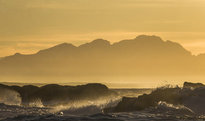 Wall Mural - Sunrise on the ocean. Cape Town. False Bay. South Africa