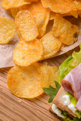 Scattered chips on wooden table