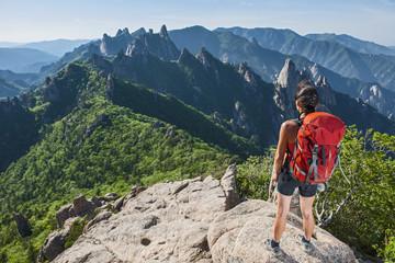 Female hiker enjoying the view from ridge at Seoraksan National park, Gangwon, South Korea