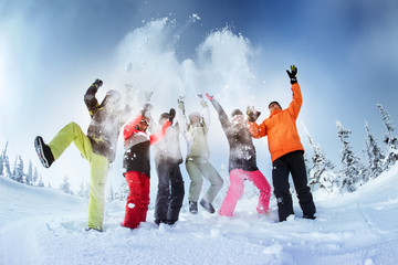 Group of friends snowboarders having fun on the top of mountain in Sheregesh resort