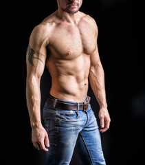 Unrecognizable young man with naked muscular torso
