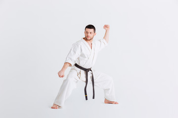 Male fighter standing in defensive stance