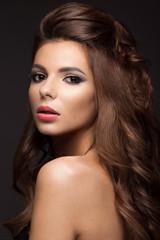 Beautiful woman with evening make-up, long straight hair . Smoky eyes. Fashion photo.