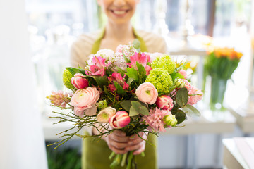close up of woman holding bunch at flower shop