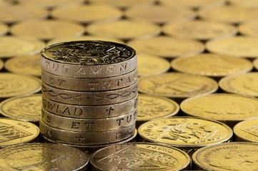 British pound coins in a neat stack.