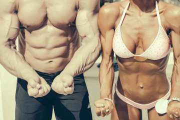 Woman and man show perfect body