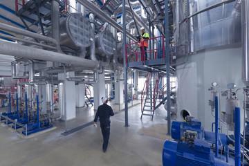 Engineers at work in geothermal power station