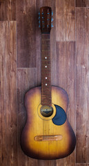 Acoustic guitar on a wooden background
