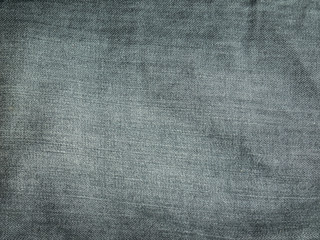 Texture of grey jeans background