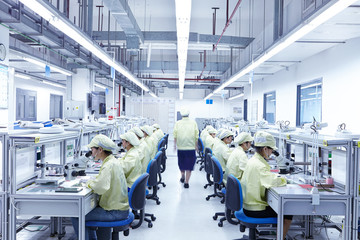Supervisor overseeing quality check station at factory producing flexible electronic circuit boards. Plant is located in the south of China, in Zhuhai, Guangdong province
