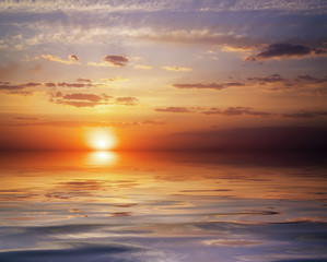 Beautiful colorful sunset sky and ocean. Sunrise in the sea. Sky