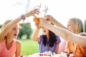 Girls toasting at summer garden party
