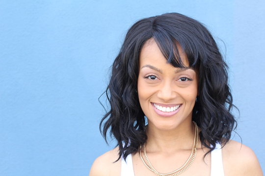 Laughing African American woman with an wavy hairstyle and good sense of humor smiling