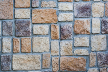 wall built of rectangular stones of different colors and textures