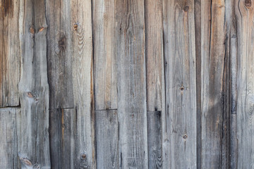Wooden background of the old, rotten planks.