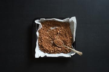 Homemade edible crystallized chocolate soil for dessert presentation