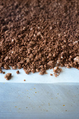 Extreme close-up of homemade edible crystallized chocolate soil for dessert presentation. Selective focus.