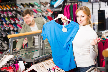 Young woman in the clothing store.