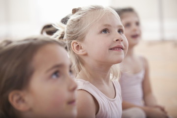 Group of girls looking up in ballet school