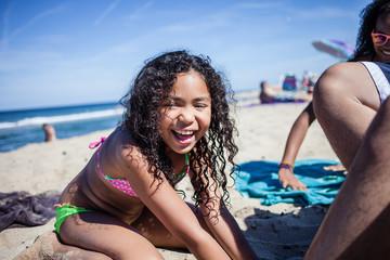 Girl playing on beach, Truro, Massachusetts, Cape Cod, USA