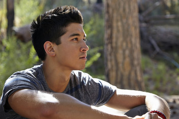 Portrait of young man in forest, Los Angeles, California, USA