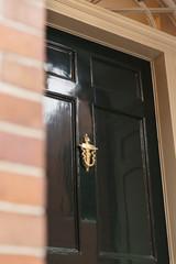 Front door close up of a brass door knocker