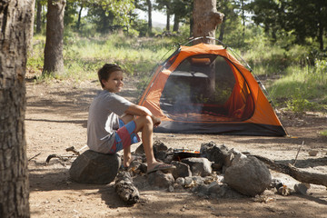 Teenage boy preparing campfire, Indiahoma, Oklahoma, USA