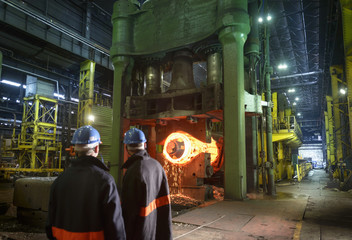 Steelworkers with 10,000 tonne forging press in steelworks