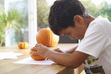 Boy drawing at dining table