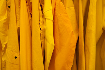 Bright Yellow rain jackets background coat