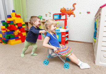 Children play with toy stroller in daycare
