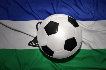 black and white football ball on the national flag of lesotho