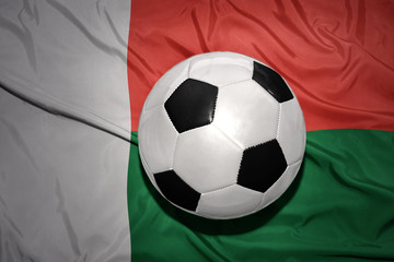 black and white football ball on the national flag of madagascar
